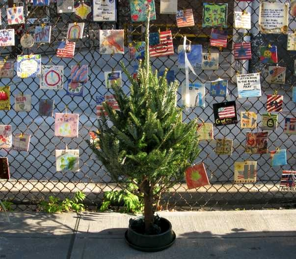 Tiny Christmas Tree in fron on 9/11 Tile Memorial