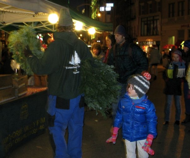 Man Giving Away Christmas Wreathes in Union Square